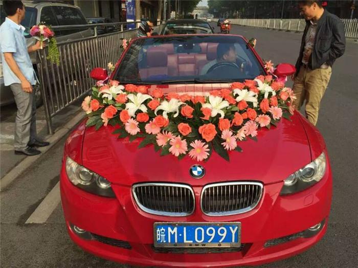 安徽良友婚车红色宝马敞篷车领衔新款奥迪车队来到康